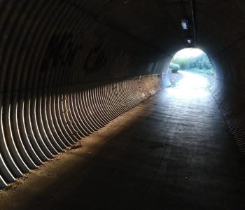 Shared-use pathway tunnel with light at end